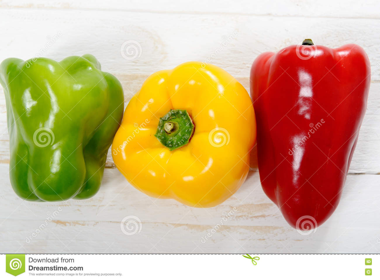 Fresh yellow, red and green bell peppers
