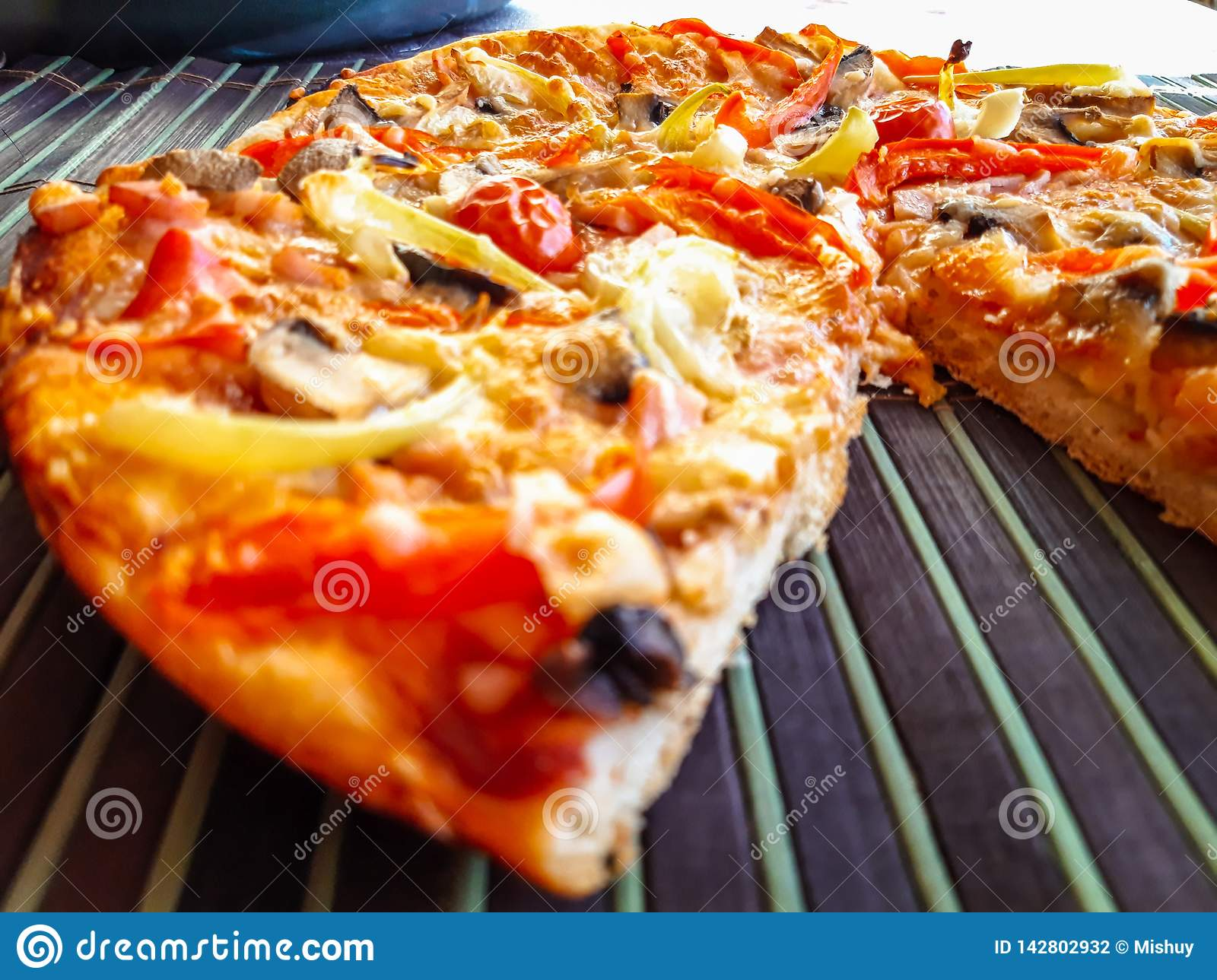 Freshly baked pizza with ham