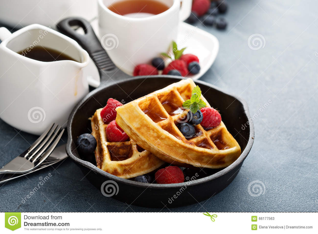 Freshly baked waffles with berries for breakfast