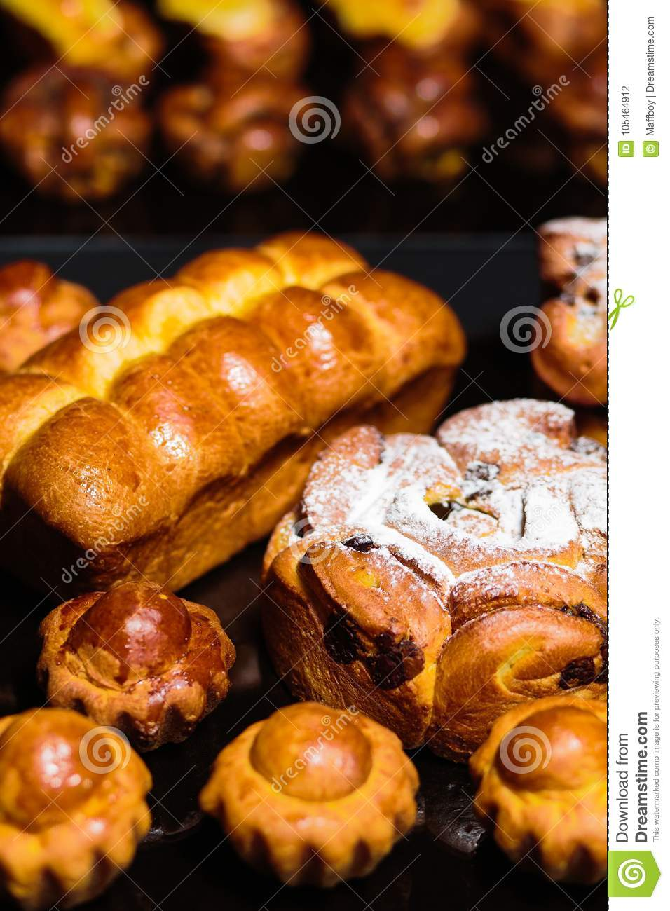 Freshly bread buns and bakery products on a table