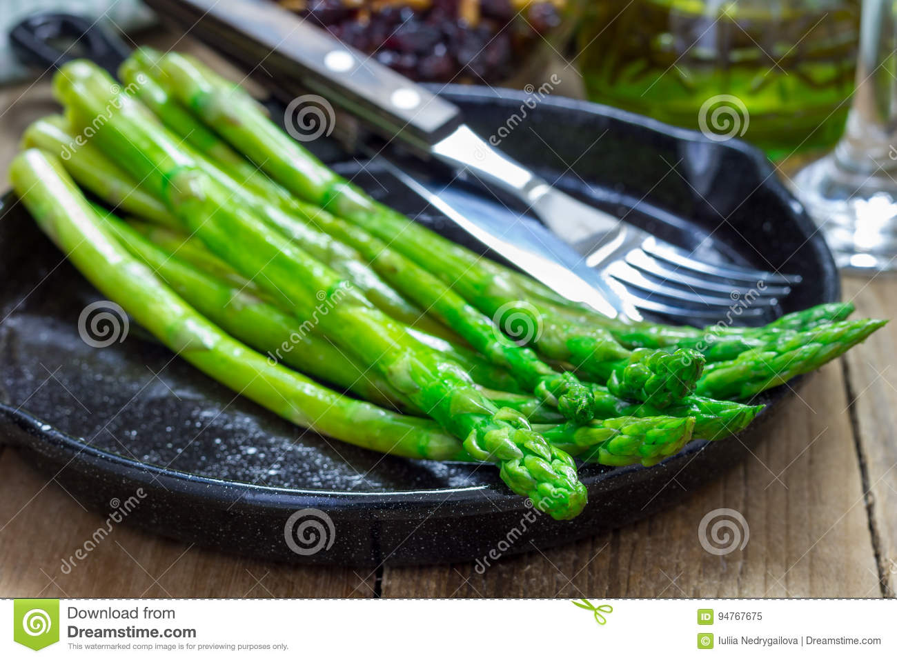 Freshly Cooked Asparagus Appetizer On Cast Iron Skillet Stock Photo