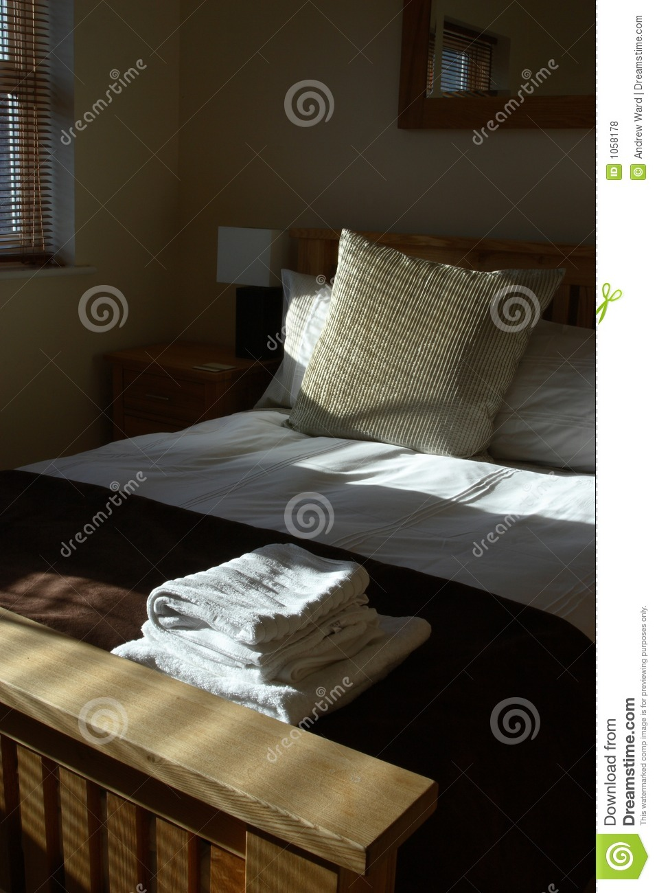 Freshly Made Bed In A Smart Hotel Room Stock Photo