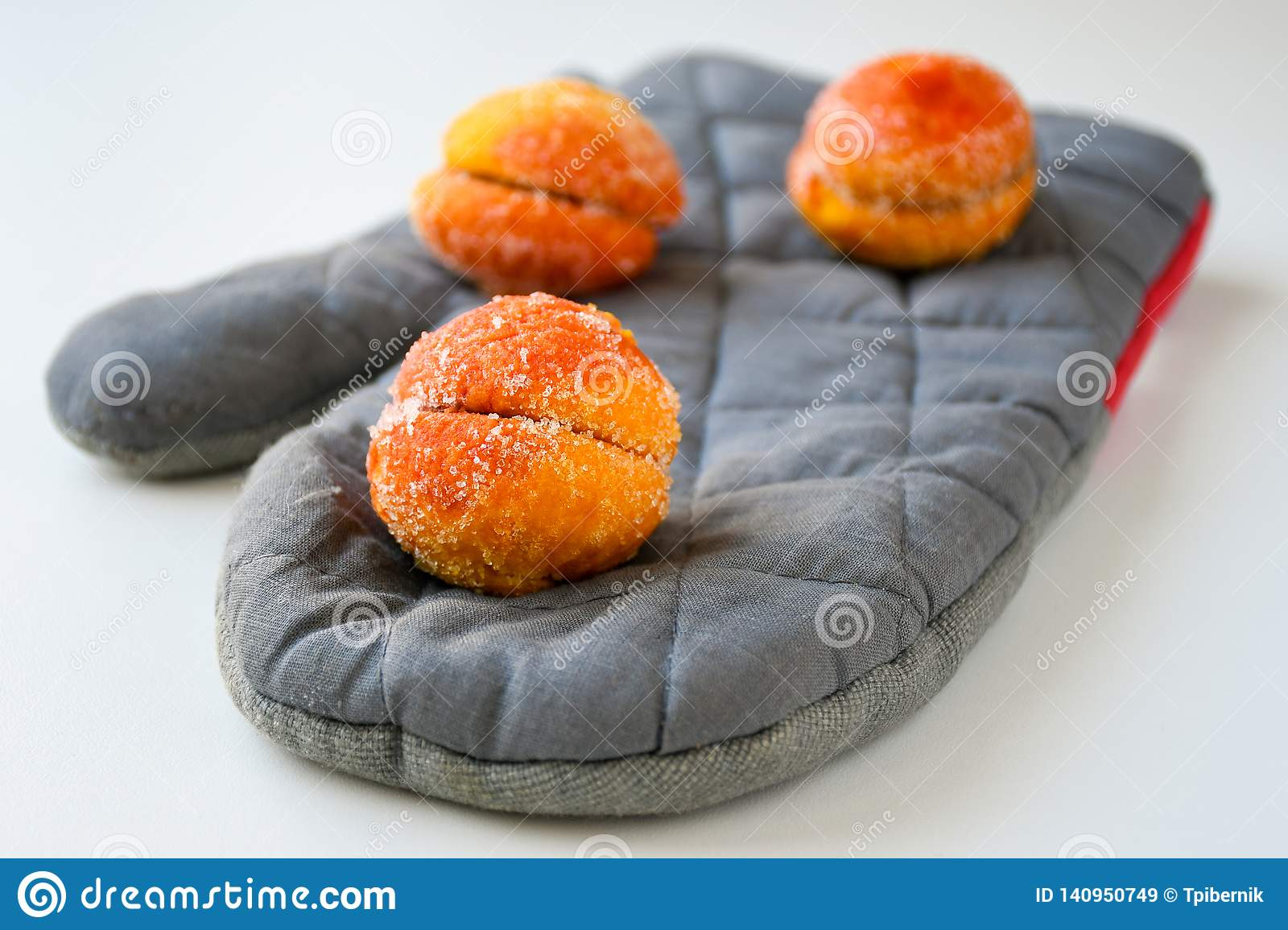 Freshly made sweet apricots with sugar coating