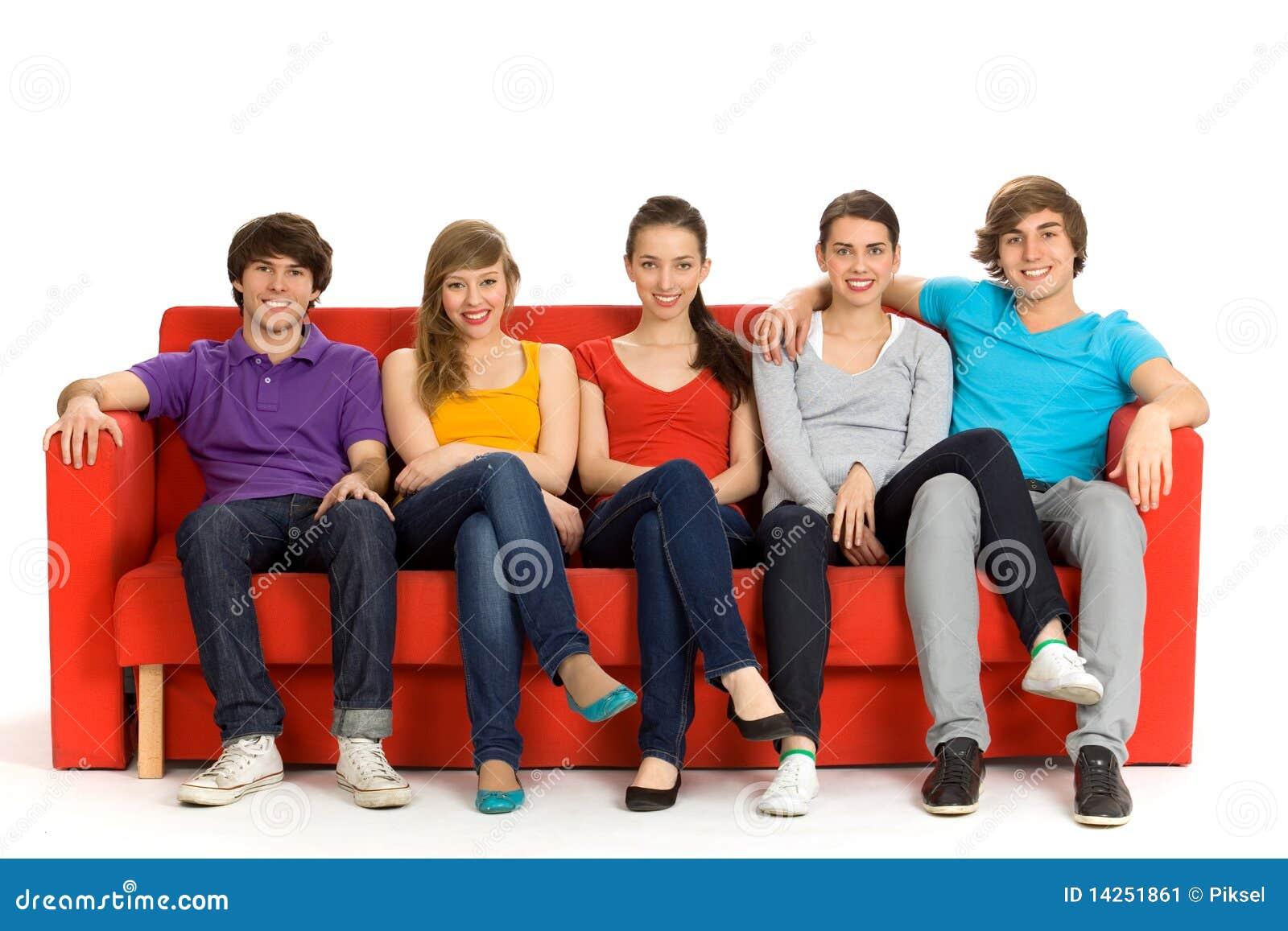 freunde die auf couch sitzen stockbild bild von jungen m dchen 14251861. Black Bedroom Furniture Sets. Home Design Ideas