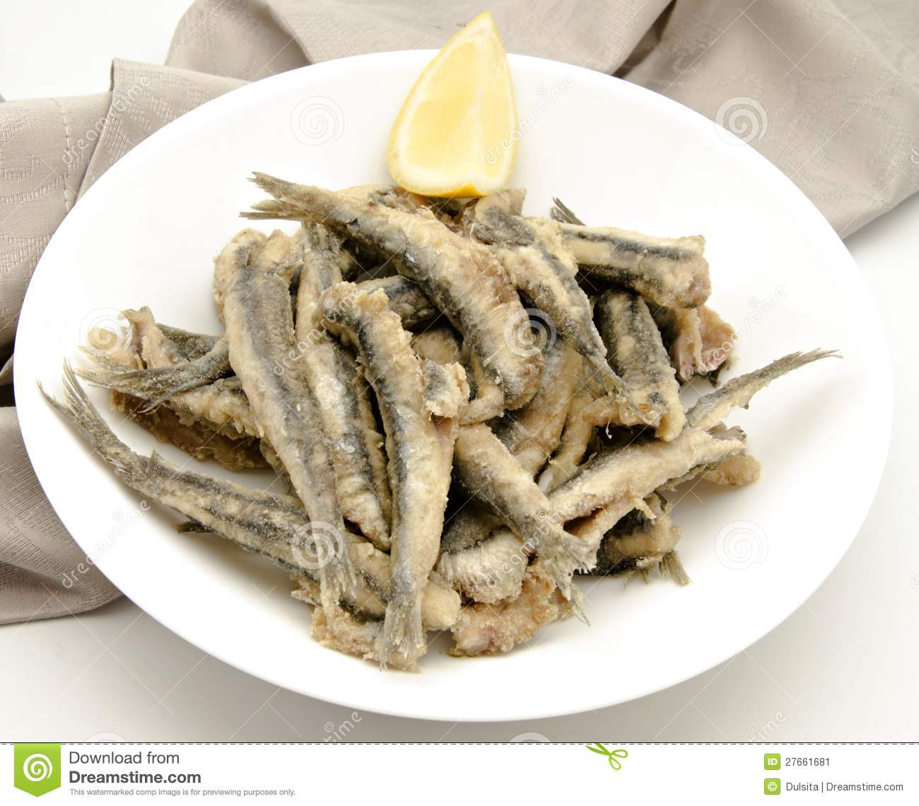 Fried anchovies typical of Spain served on a palte.