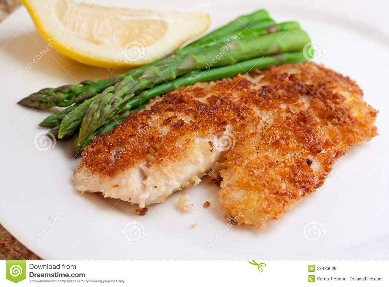 Fried breaded fish with asparagus and lemon royalty free for Breaded pan fried fish