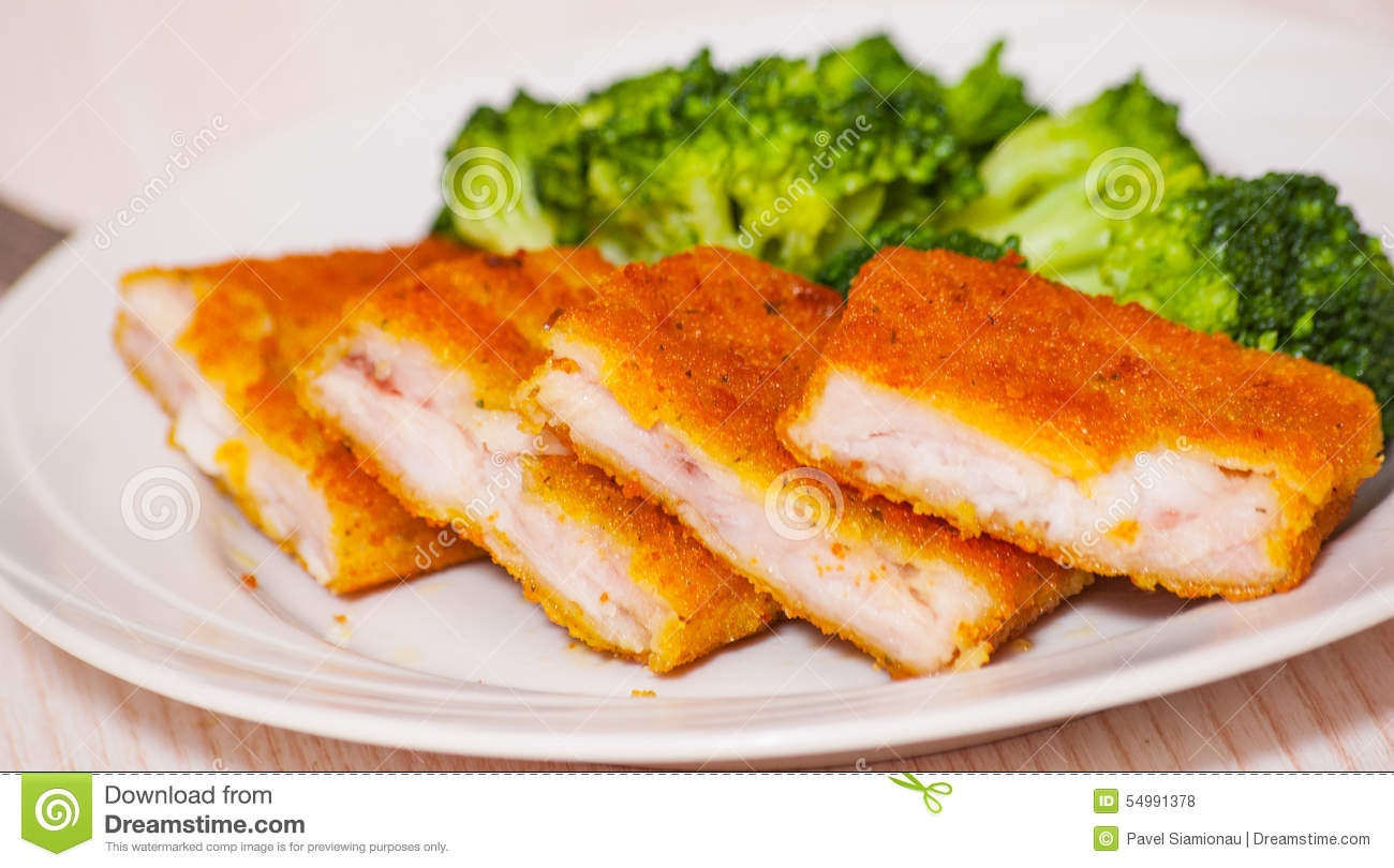 Fried breaded fish fillets with broccoli stock photo for Breaded pan fried fish