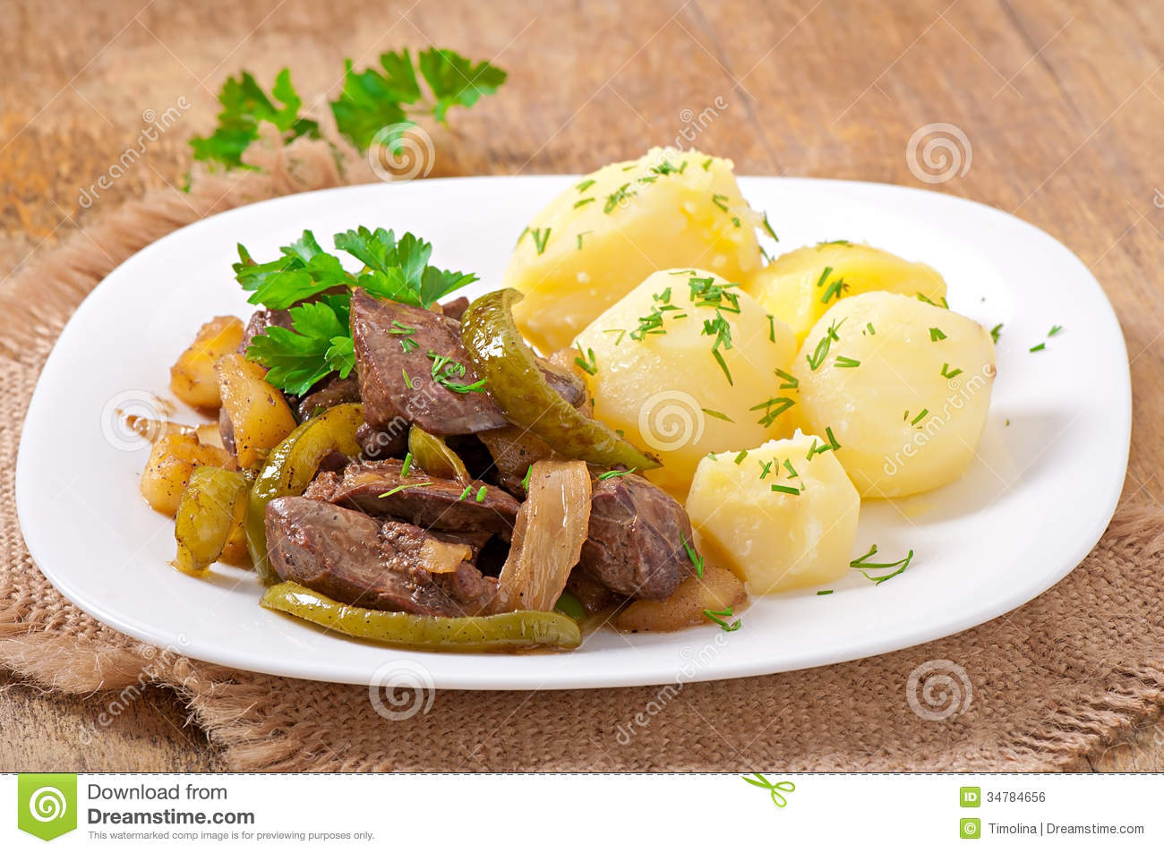 Fried chicken liver with apples, sweet pepper and onions.