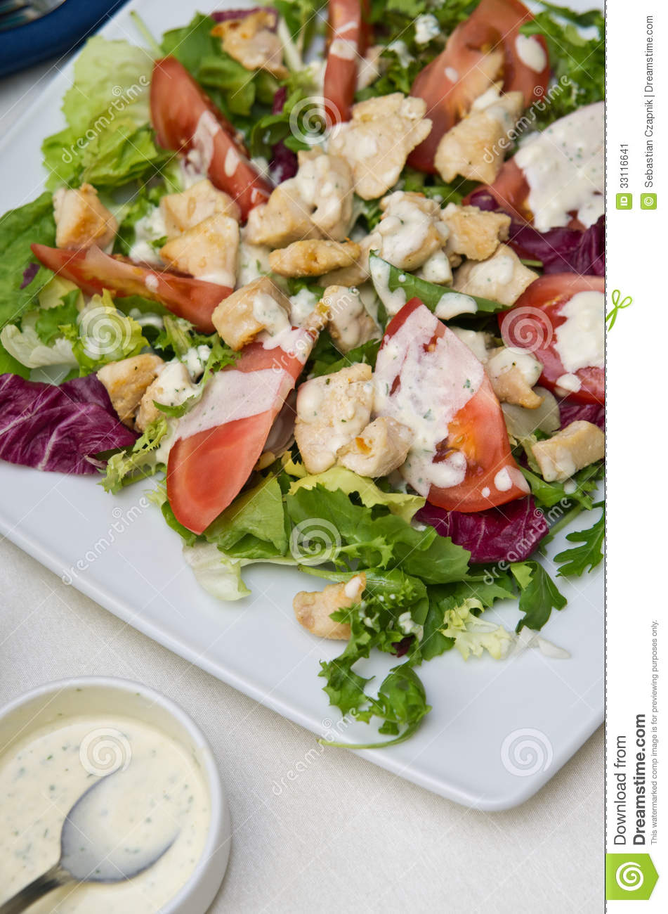 Delicious food composition of fried chicken salad with tomatoes ...