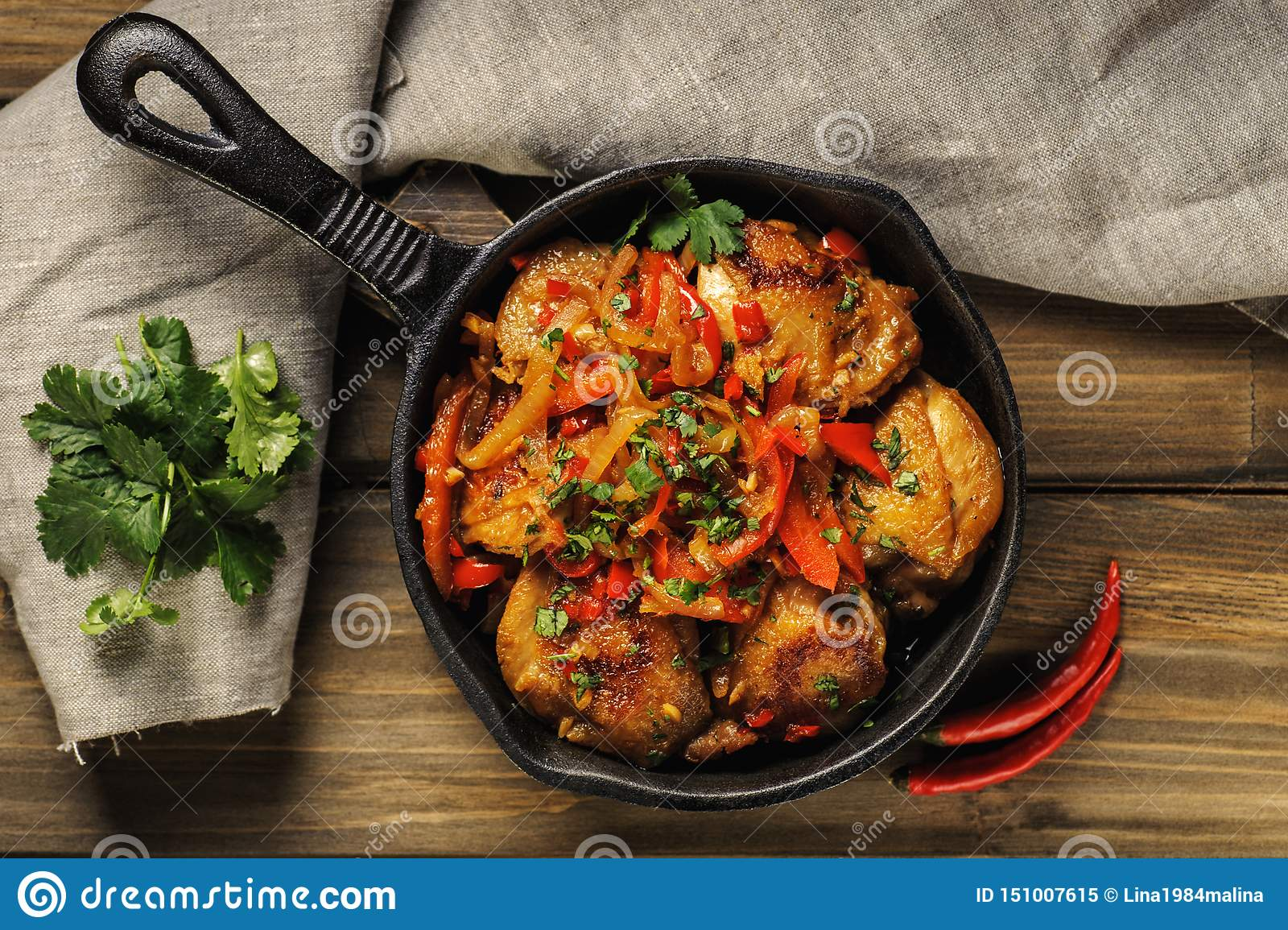 Fried chicken in spicy sauce with vegetables