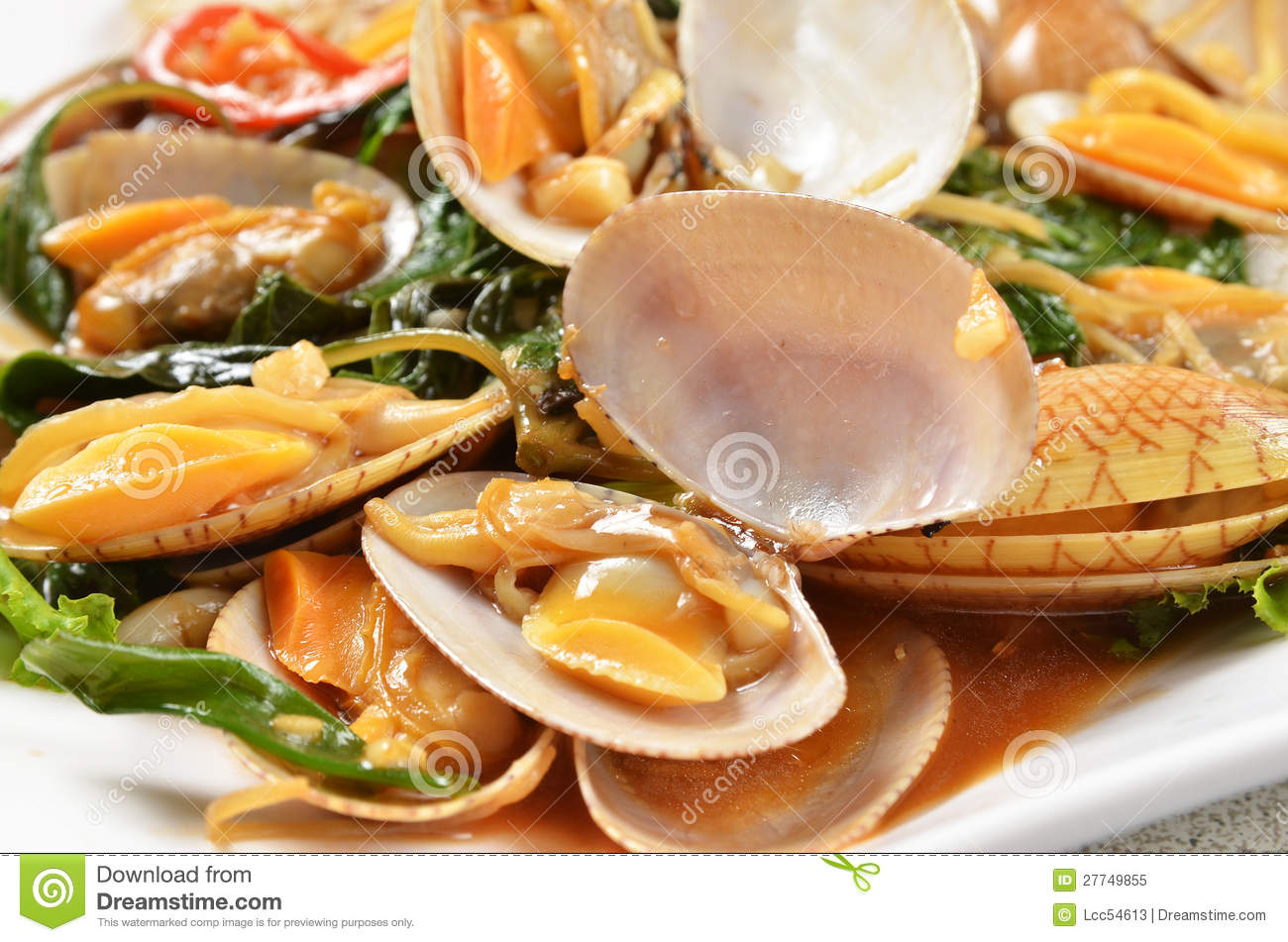 stir fried clams with basil - stock photo
