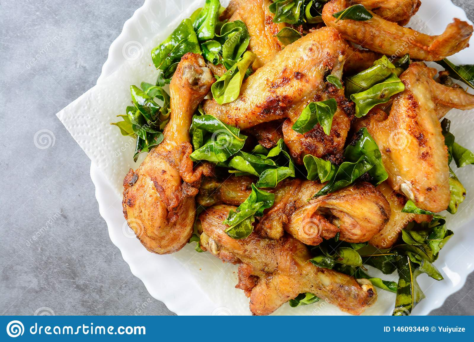 Fried crispy chicken wings with herbs