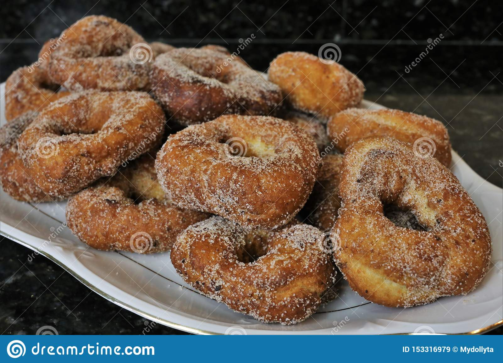 Fried donuts with sugar a typical sweet in Easter and Lent