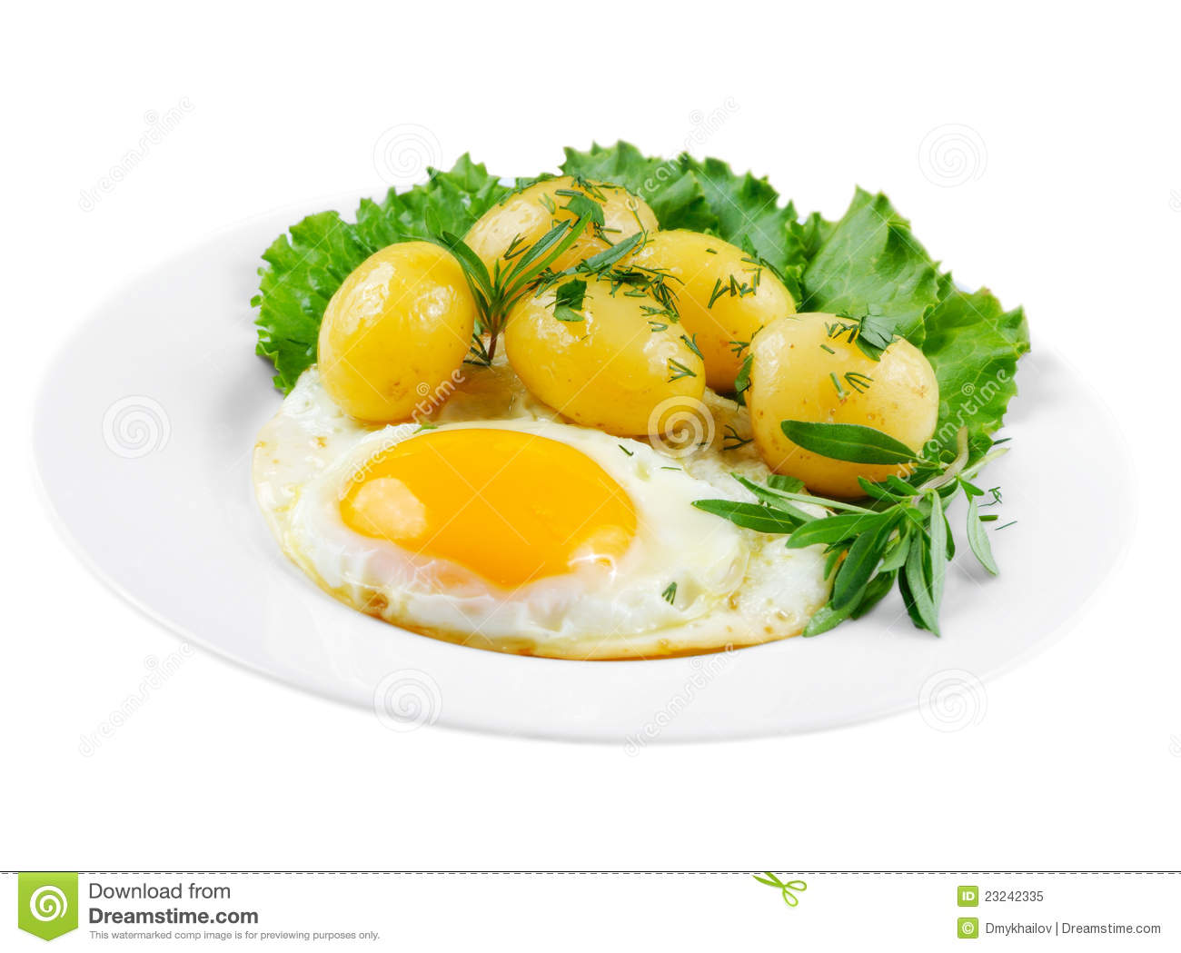 Fried egg with boiled new potatoes, lettuce and herbs isolated on ...