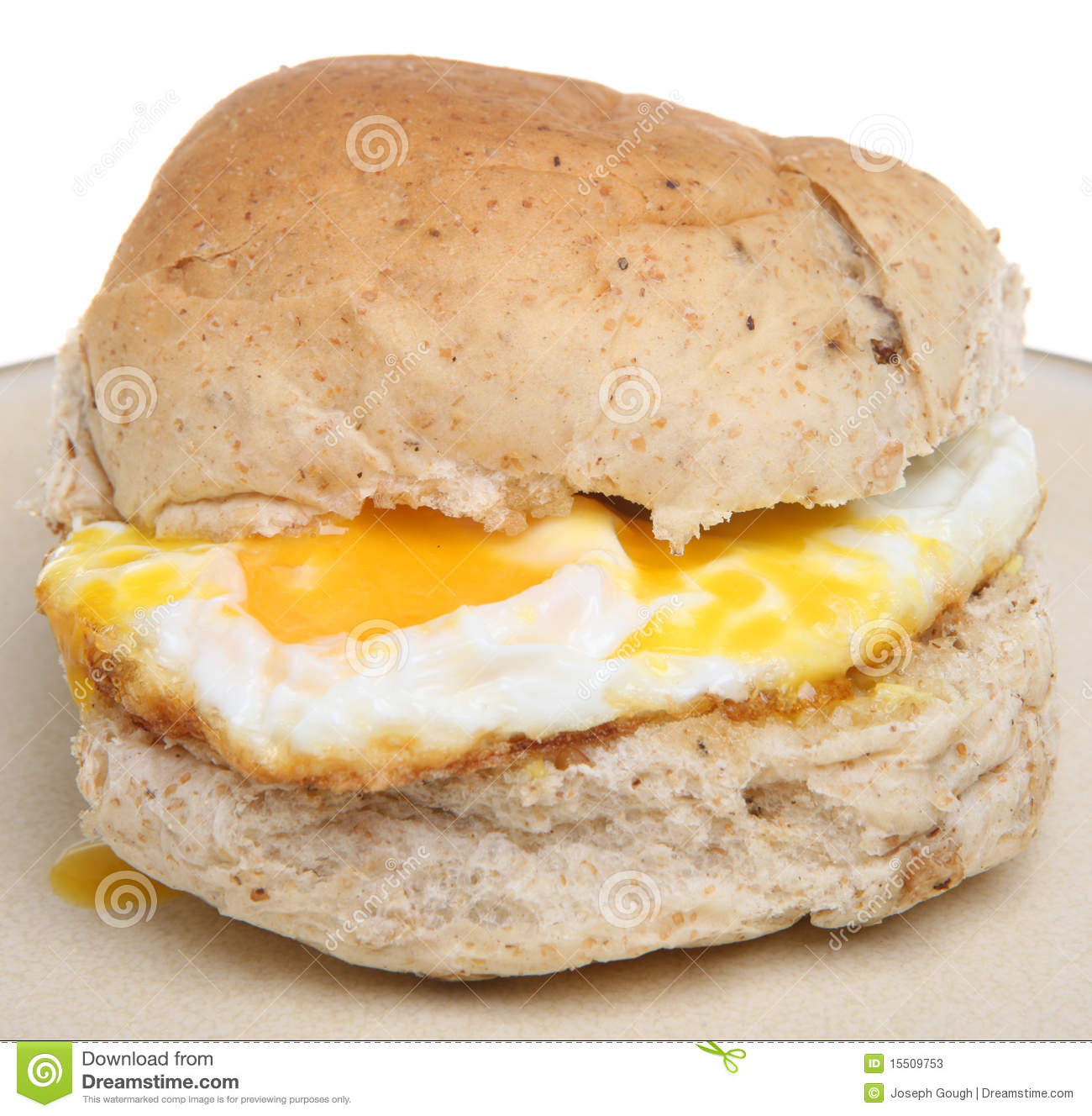 Granary bread roll with fried egg.