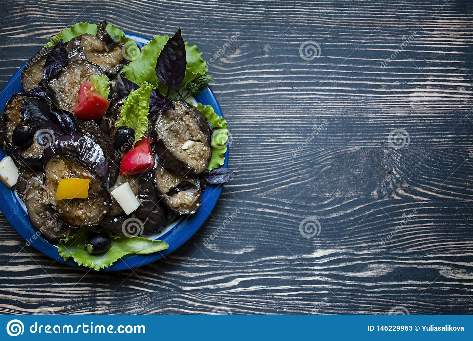 Fried eggplant with fresh salad and spices