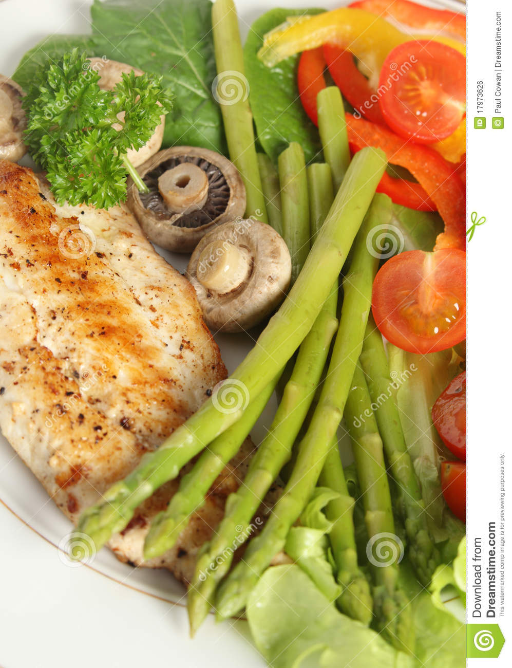 Fried fish and asparagus high angle vertical royalty free for Fish and asparagus