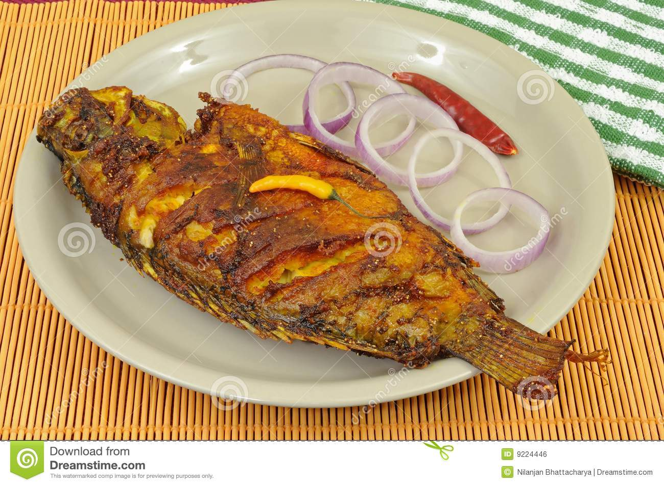 Fried fish decorated with onion rings stock photo image for What to eat with fried fish