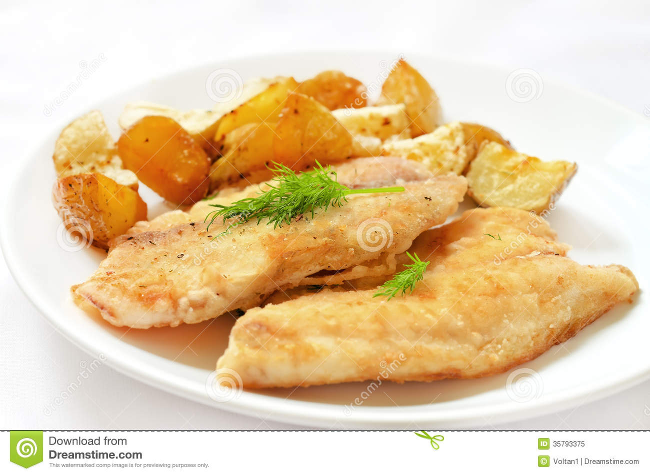 Fried fish fillet with baked potatoes royalty free stock for Fried fish fillet