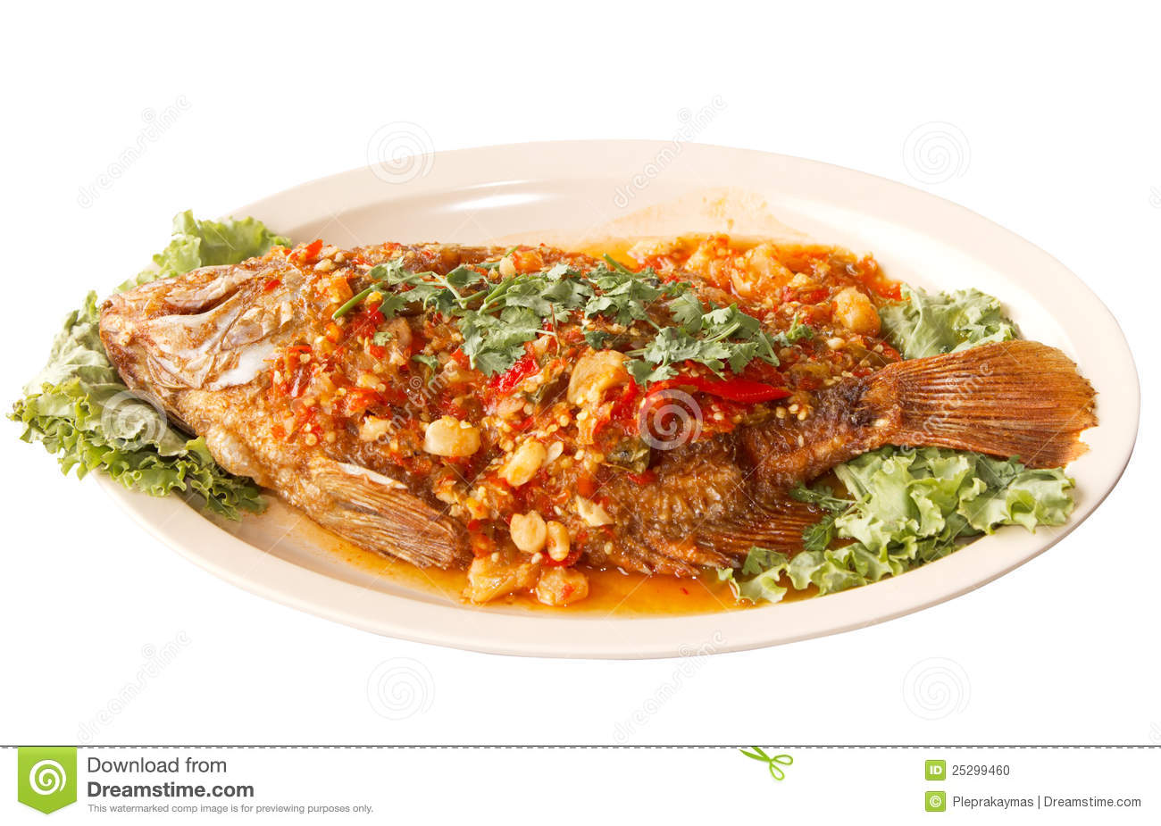 Fried fish with fresh herbs and sweet spicy sauce on plate isolate ...