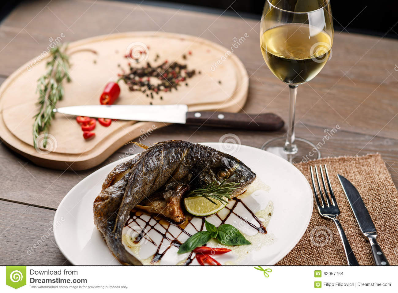 Fried fish with glass of wine stock photo image 62057764 for Wine with fish