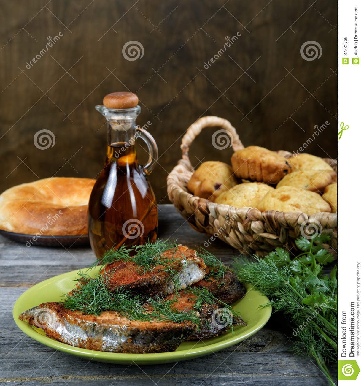 Fried fish with greens and oil royalty free stock image for Frying fish in olive oil