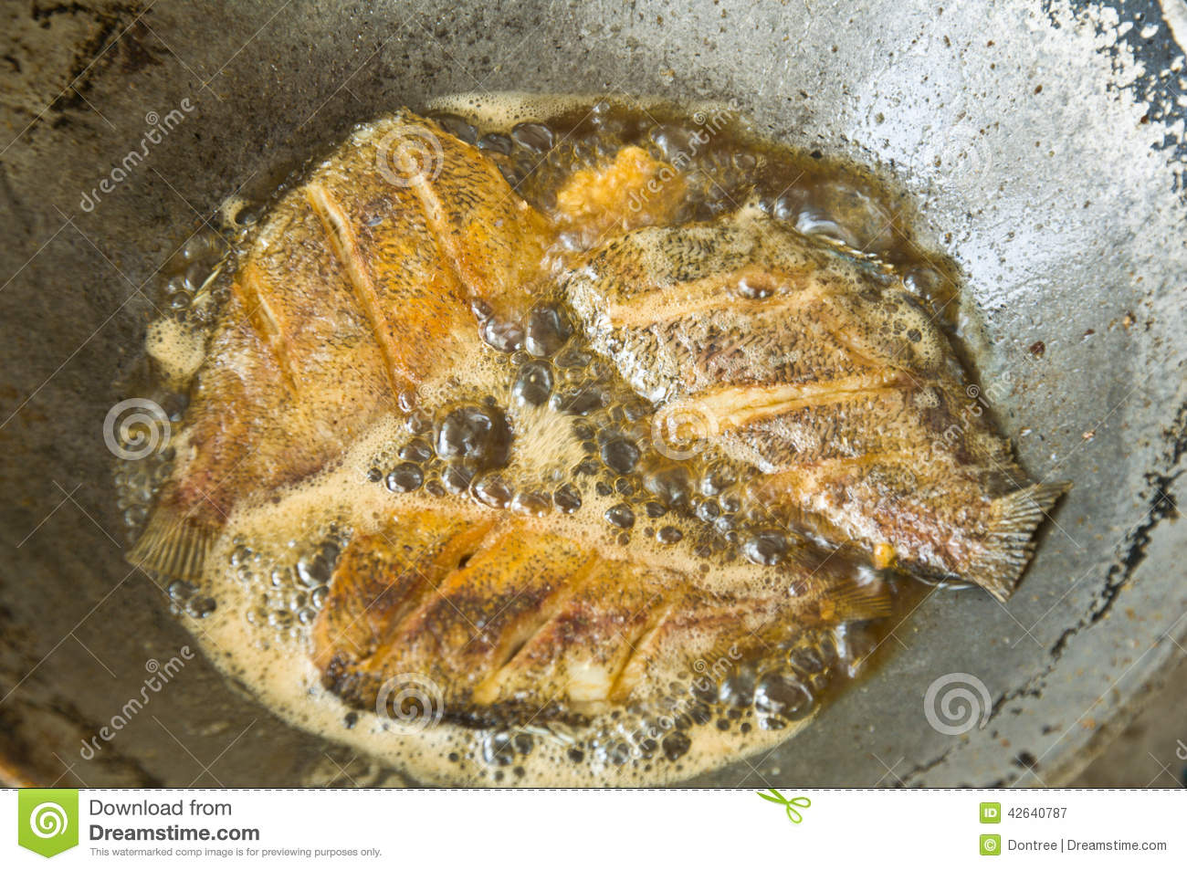 Fried fish in the iron pan stock photo image 42640787 for Iron in fish