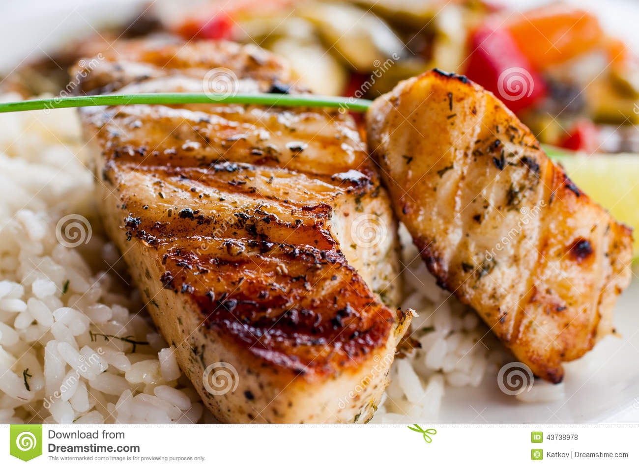 Fried fish with rice and vegetables stock photo image for Baked fish and rice
