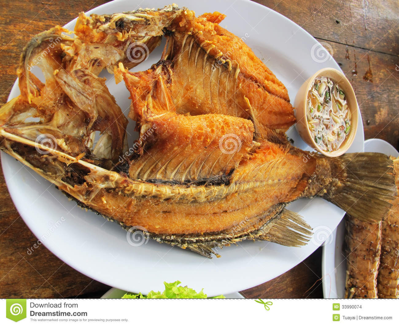 Fried fish silver perch with fish sauce stock images for Fish as food