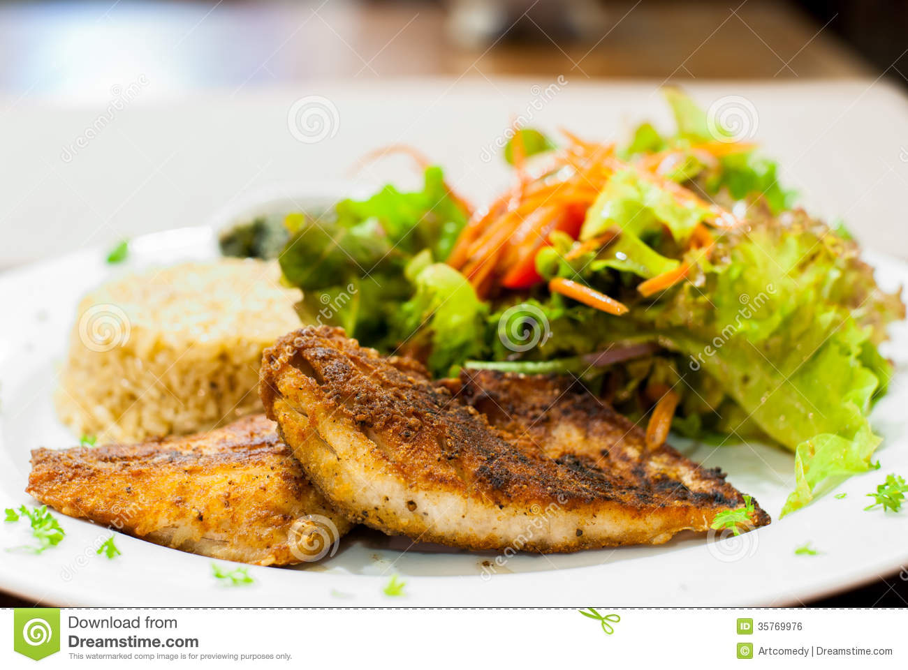 Fried fish steak with salad and fried rice stock photo for Rice dishes with fish