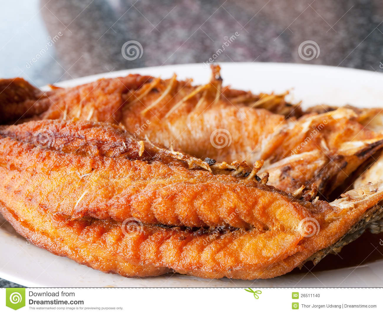 Fried fish at thai restaurant stock photo image 26511140 for Fried fish restaurants