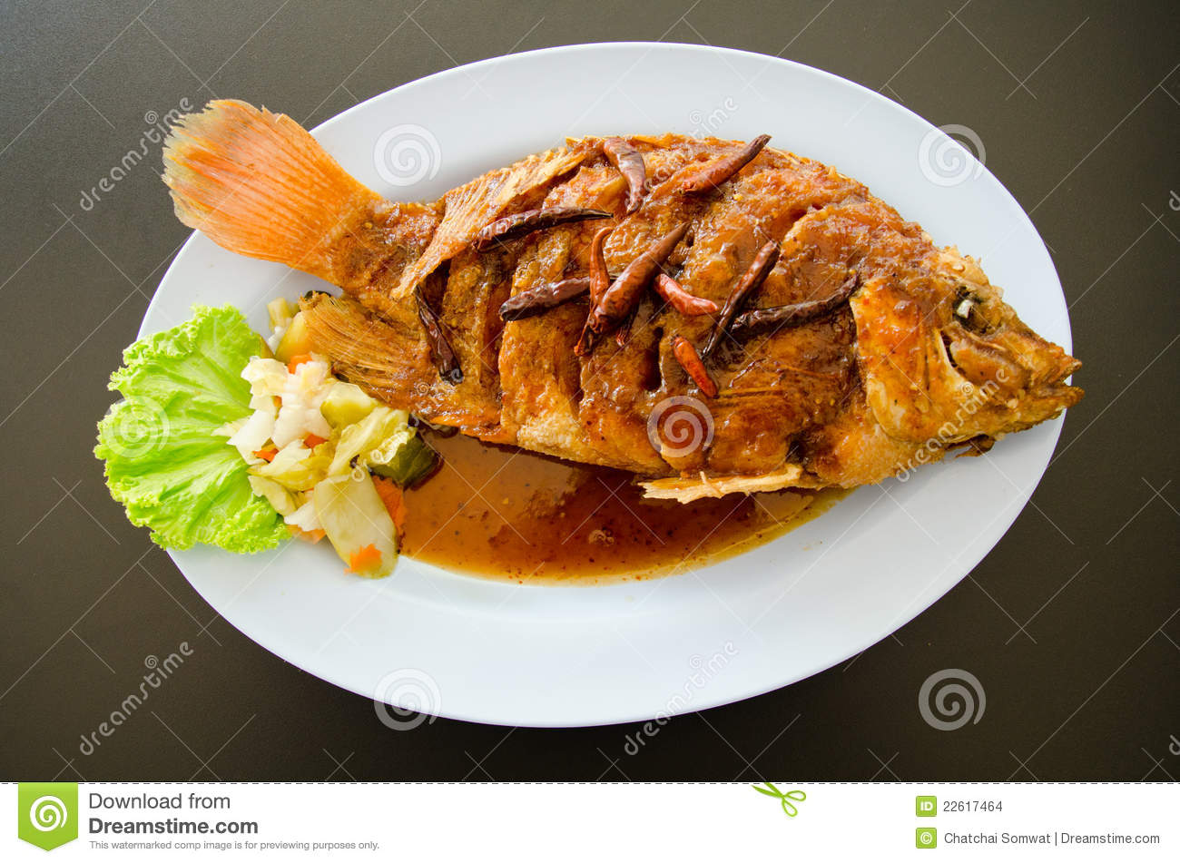 Fried Fish Topped With Sweet Sauce. Stock Images - Image: 22617464