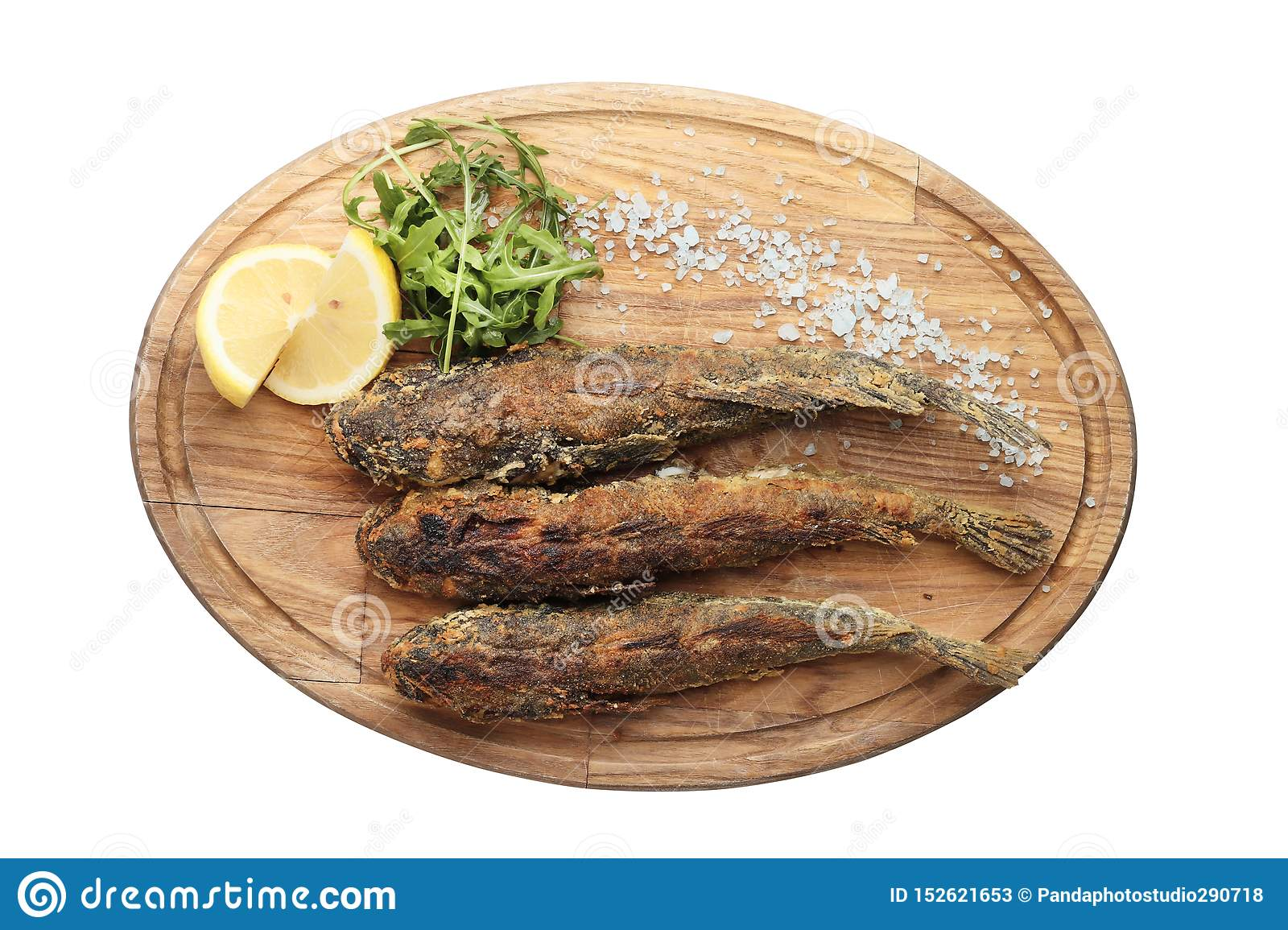 Fried fish on a wooden board isolated on white background