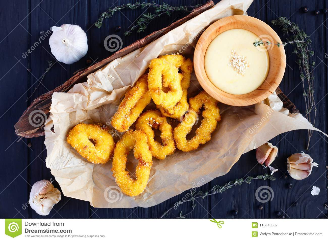 Fried Onion Rings In Breadcrumbs With Creamy Sauce