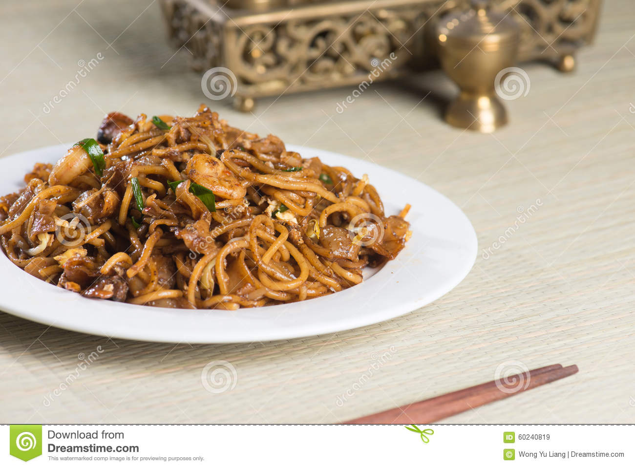 Fried Penang Char Kuey Teow which is a popular noodle dish in Malaysia ...