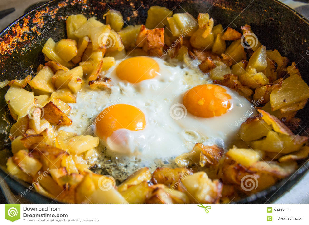 Fried Potatoes With Eggs In Pan Stock Photo - Image: 58405506