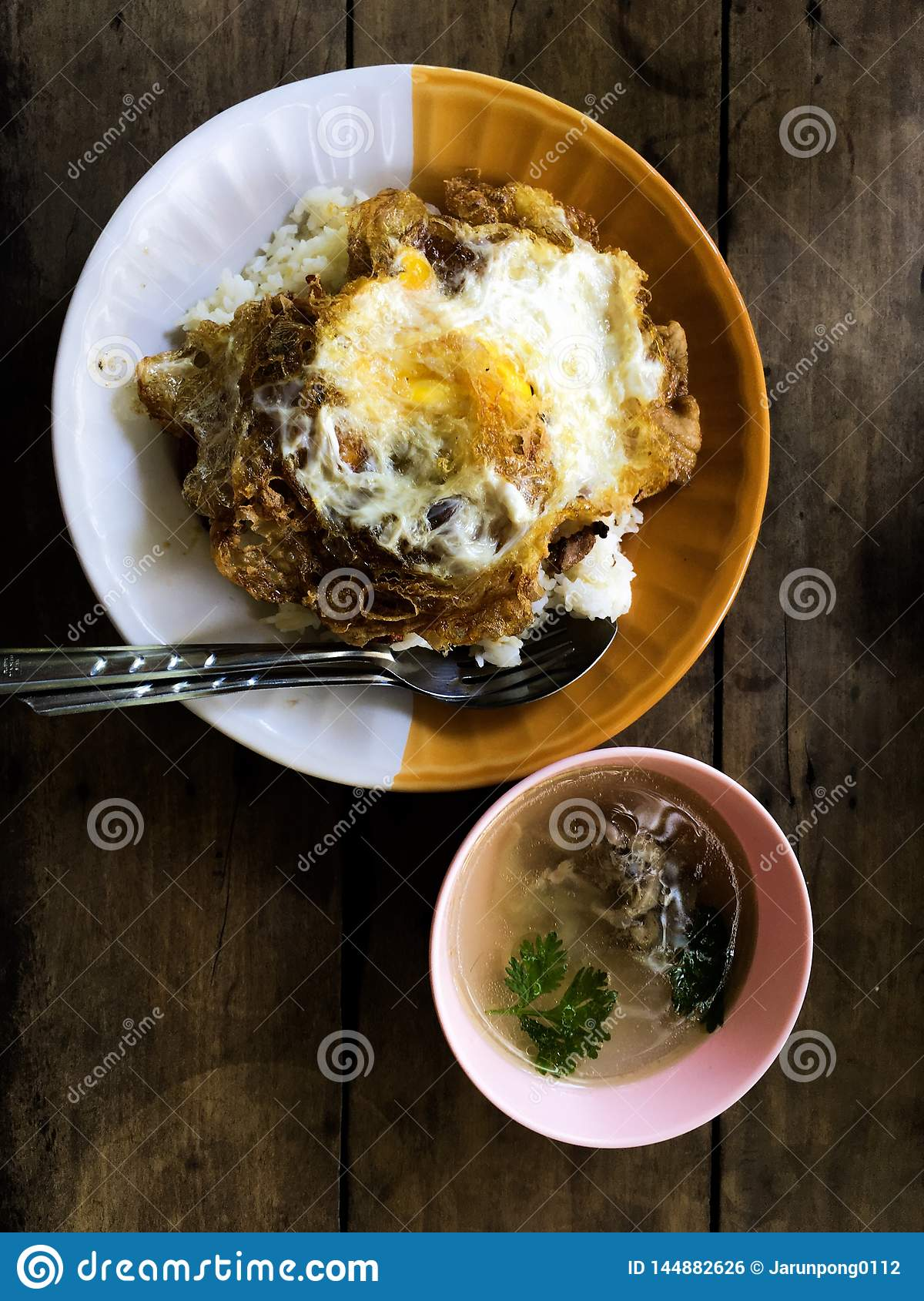 Fried rice and fired egg. Popular thai food.