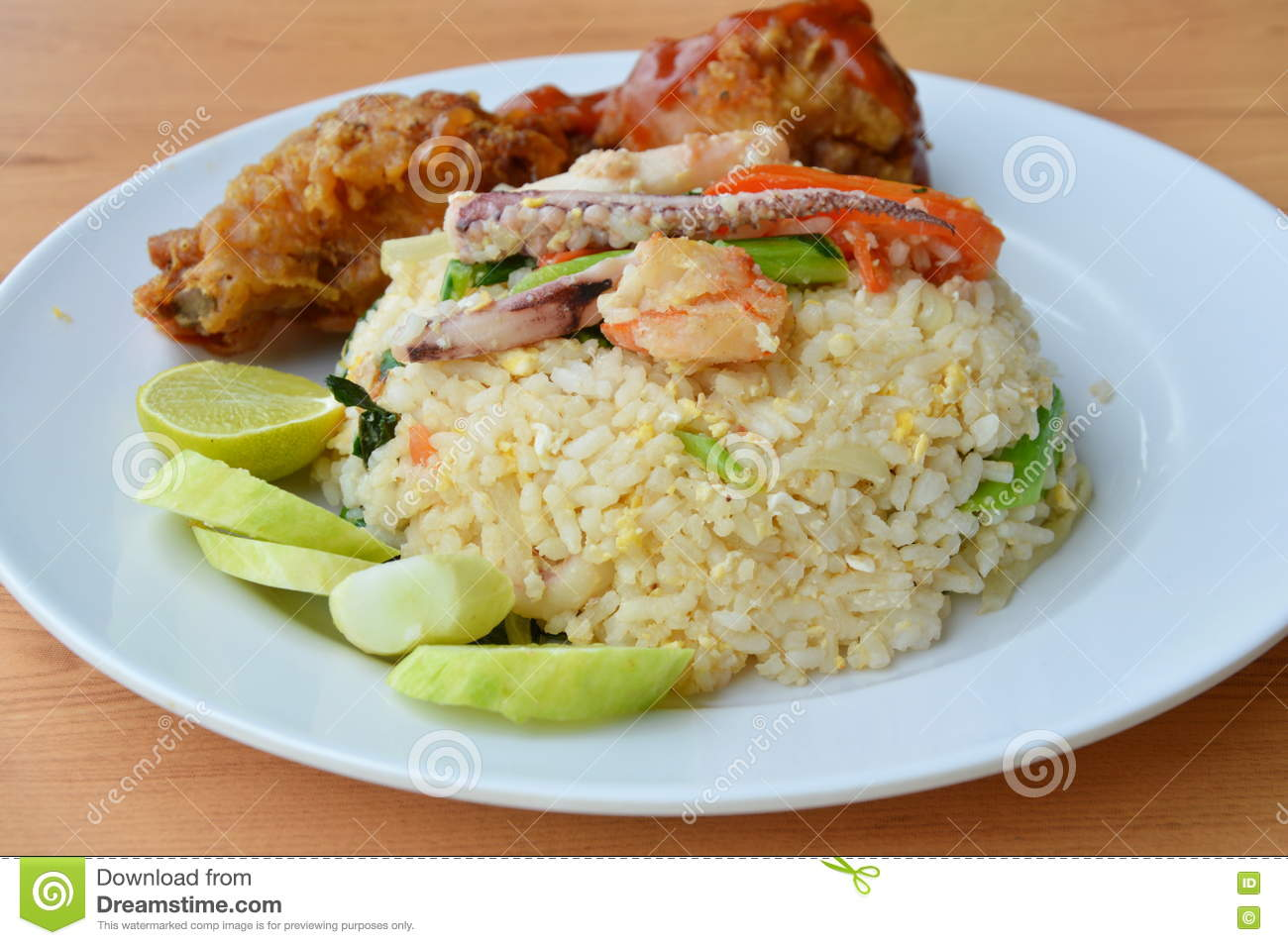 Fried Rice With Mixed Seafood And Crispy Chicken On Plate ...