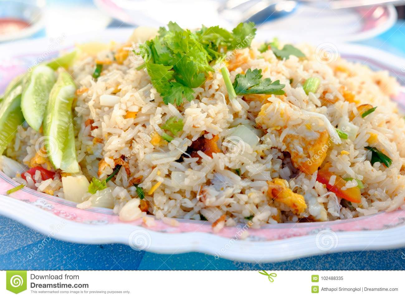 Fried rice with crab meat, eggs and vegetables on the plate