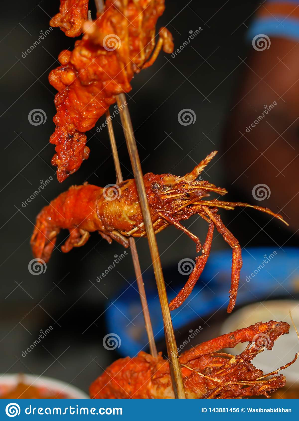 Fried sea food in a stick