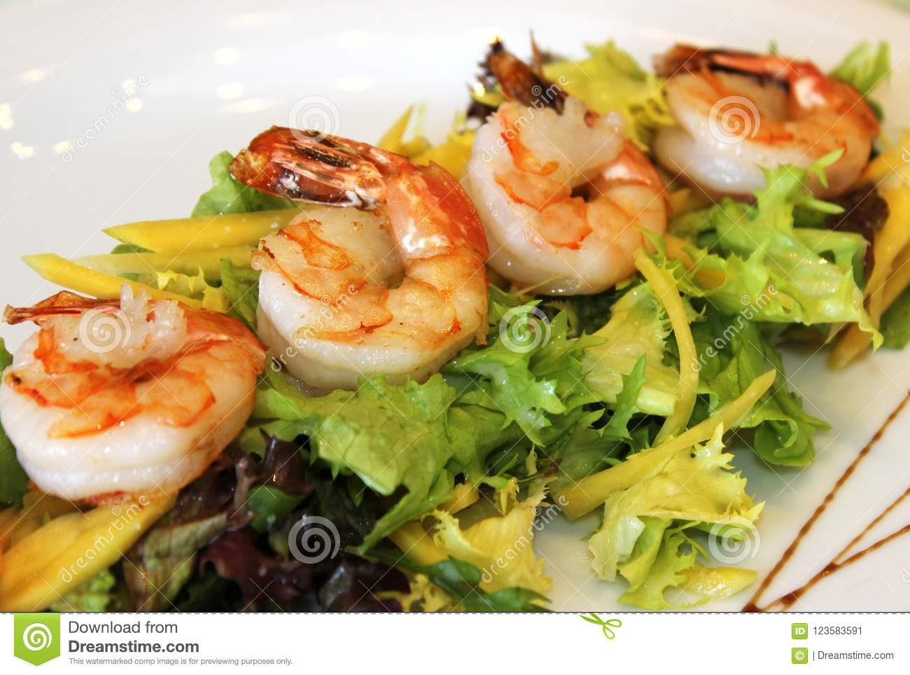 Fried shrimps with greens