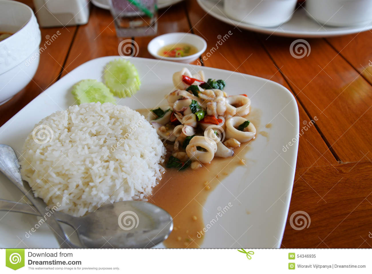 Spicy fried squid with basil leaves and rice thai food.