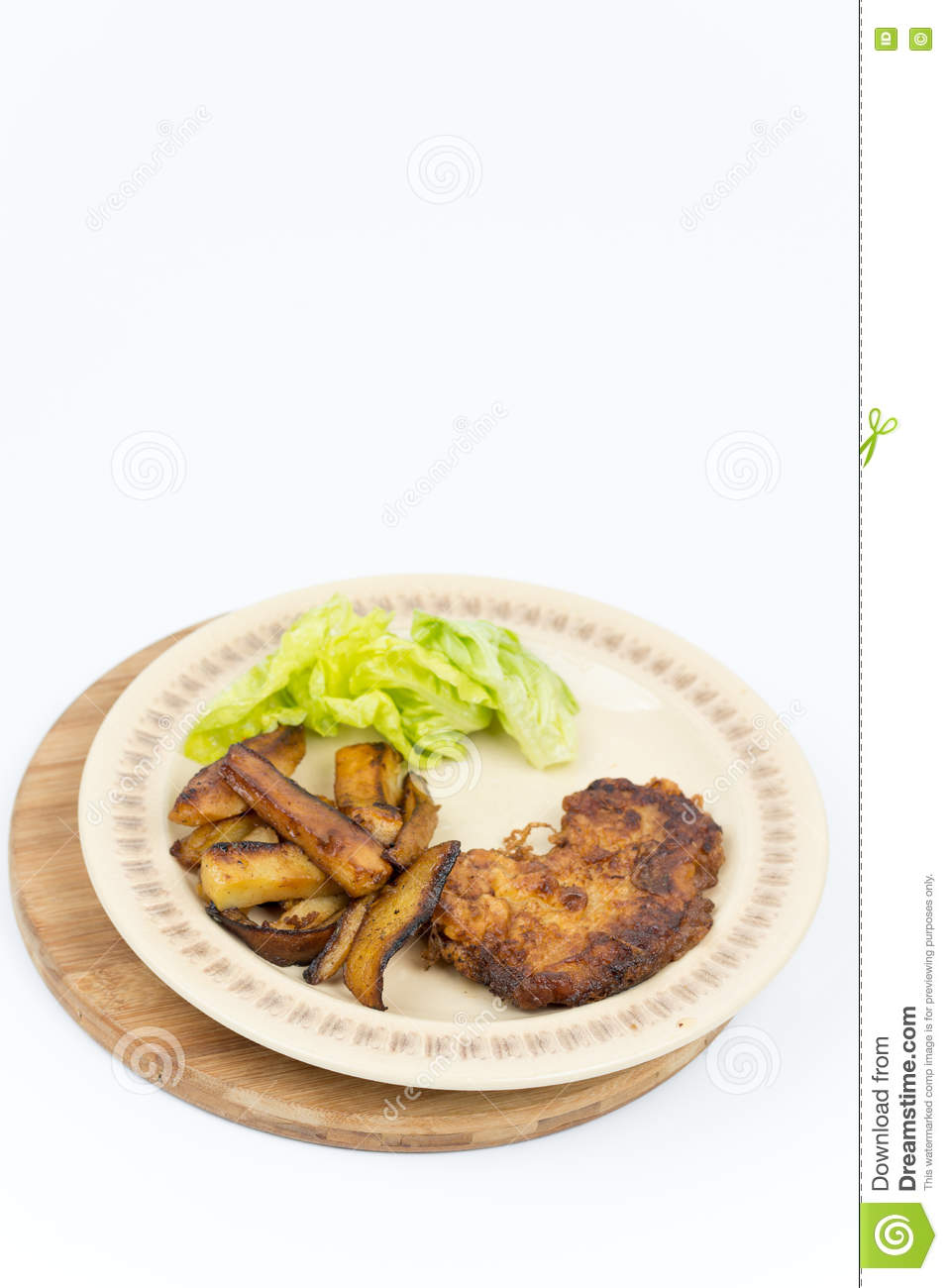 Fried steak potatoes and lettuce