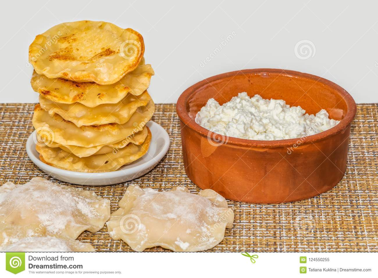 the fried yellow tortillas with cottage cheese lie like a pyramid on