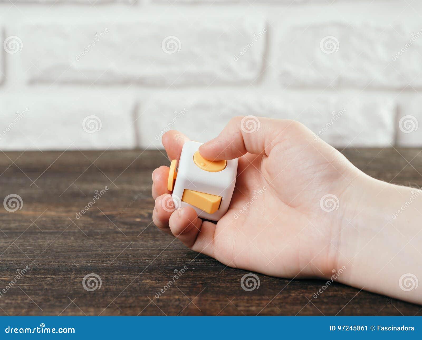 Friemel de vingersstuk speelgoed van de kubusspanning