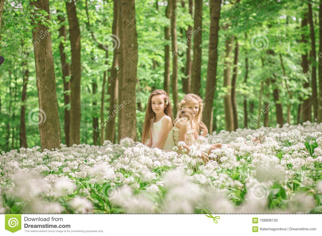 Friend outdoor in blossoming forest