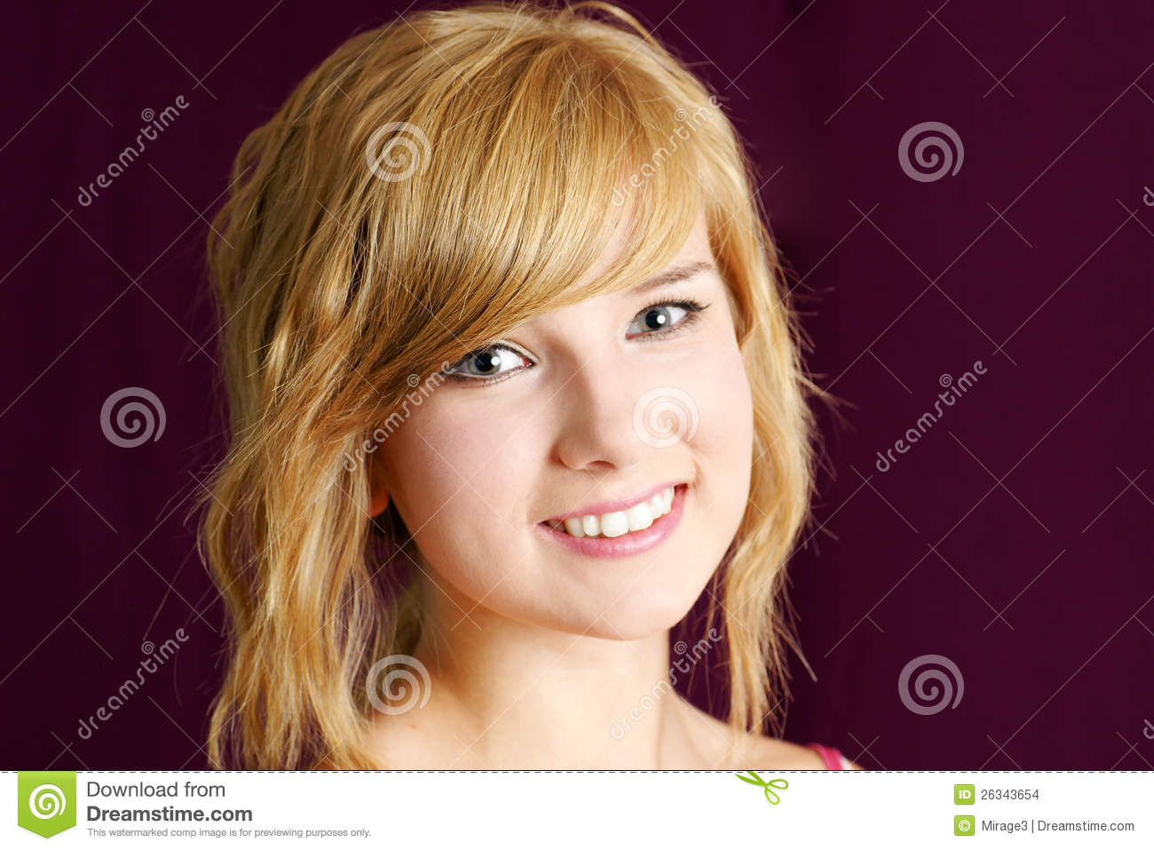 Friendly Blond Teenager Girl Smiling