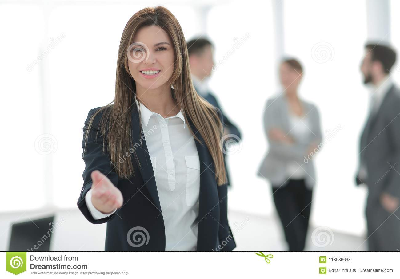 Friendly business woman holding out her hand for a handshake