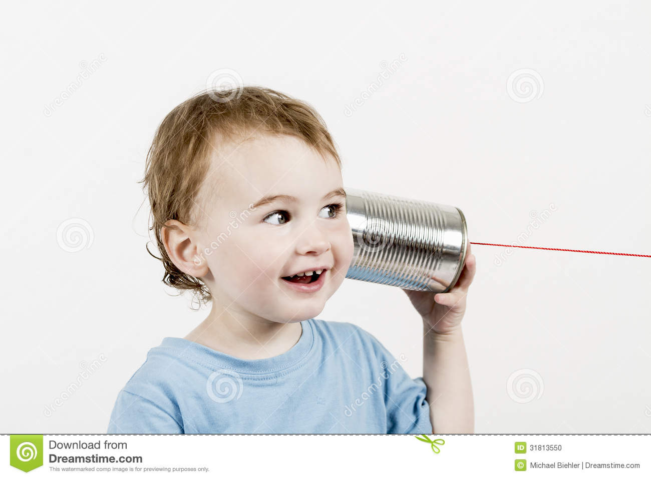 Friendly child listening to tin can phone