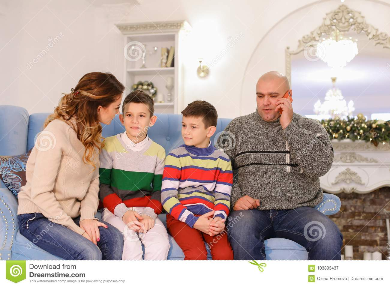 Large Family Chatting On Couch, Woman Talking On Phone -6250